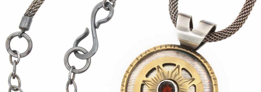 Pendant, Peggy Foy, sterling, brass, garnet